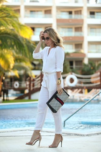 brooklyn blonde blogger jumpsuit white spring outfits pouch nude high heels sandals printed pouch gucci bag gucci white jumpsuit sunglasses sandal heels high heel sandals nude sandals