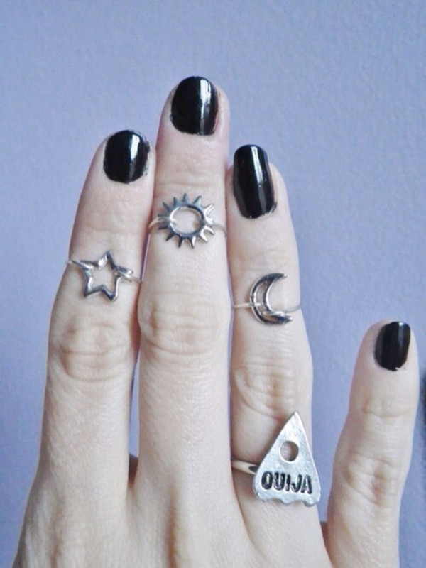 jewels sun knuckle ring jewelry ouija moon and sun stars stars ring ring silver ring silver moon silver kitchie tumblr nail polish nails middle finger ring in the middle finger black kawaii grunge pastel goth knuckle ring knuckle ring knuckle ring