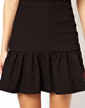 ASOS   ASOS Mini Skirt in Texture with Peplum Hem at ASOS