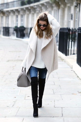 le fashion image blogger jacket sweater bag jeans shearling vest vest shearling white sweater oversized sweater oversized denim blue jeans boots black boots over the knee boots grey bag