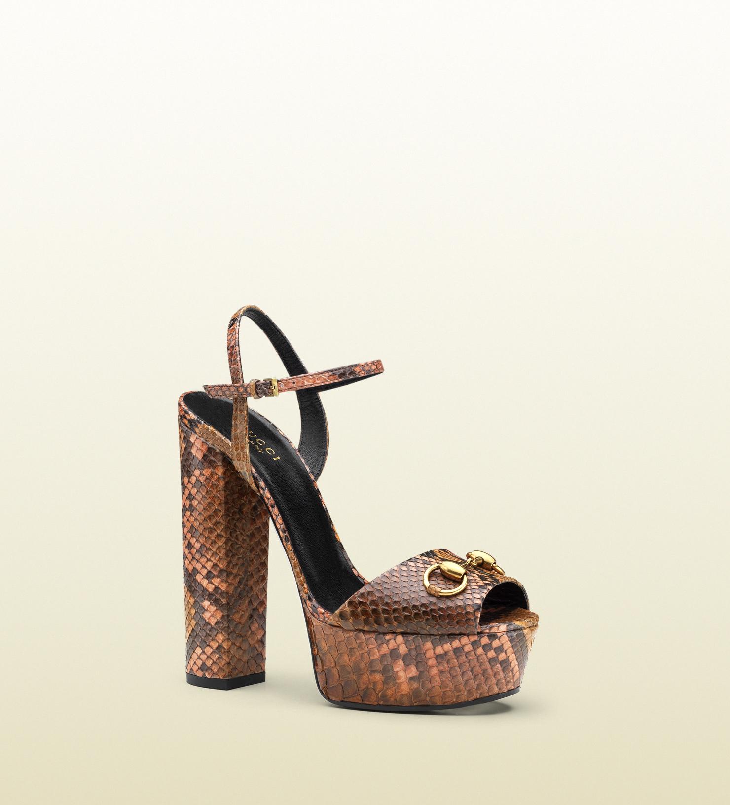 Gucci - sandalo con plateau in pitone 338961E74006496