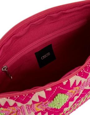 ASOS | ASOS Geo-Tribal Clutch Bag with Pom Poms at ASOS