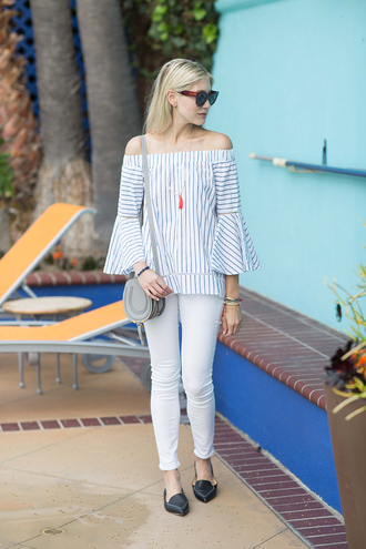 modern ensemble blogger blouse jewels bag off the shoulder long sleeves bell sleeves stripes striped top white jeans mini bag grey bag shoulder bag black flats striped off shoulder top off the shoulder top necklace belly shirt bell sleeve top pointed flats flats spring outfits