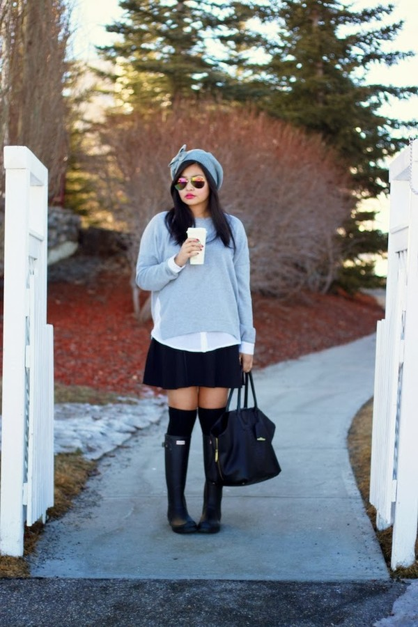 the girl with the messy hair sweater hat skirt shoes bag