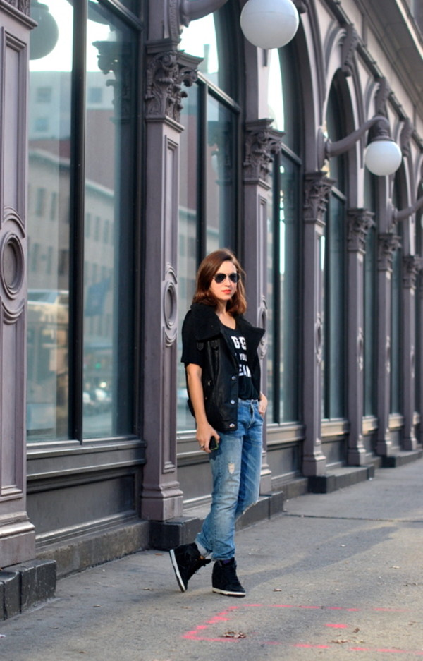 my style pill jacket t-shirt jeans shearling vest vest leather vest black vest black t-shirt quote on it denim blue jeans ripped jeans sunglasses aviator sunglasses wedge sneakers