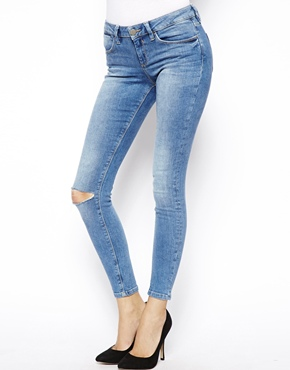 ASOS | ASOS Whitby Low Rise Ankle Grazer Jeans in Venice Mid Wash Blue with Ripped Knee at ASOS
