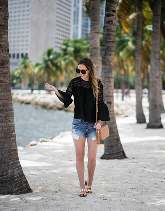 miami + dallas based lifestyle and fashion blog blogger shirt shorts shoes bag sunglasses beach j crew gucci bag black lace shirt eyelet top bell sleeves bell sleeve top black top lace top black sunglasses denim shorts denim blue shorts camel bag gucci shoulder bag gold shoes slide shoes