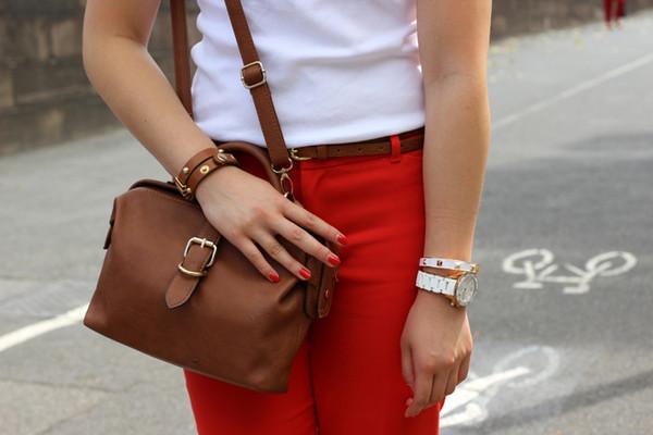 an odd girl t-shirt pants shoes bag jewels sunglasses belt