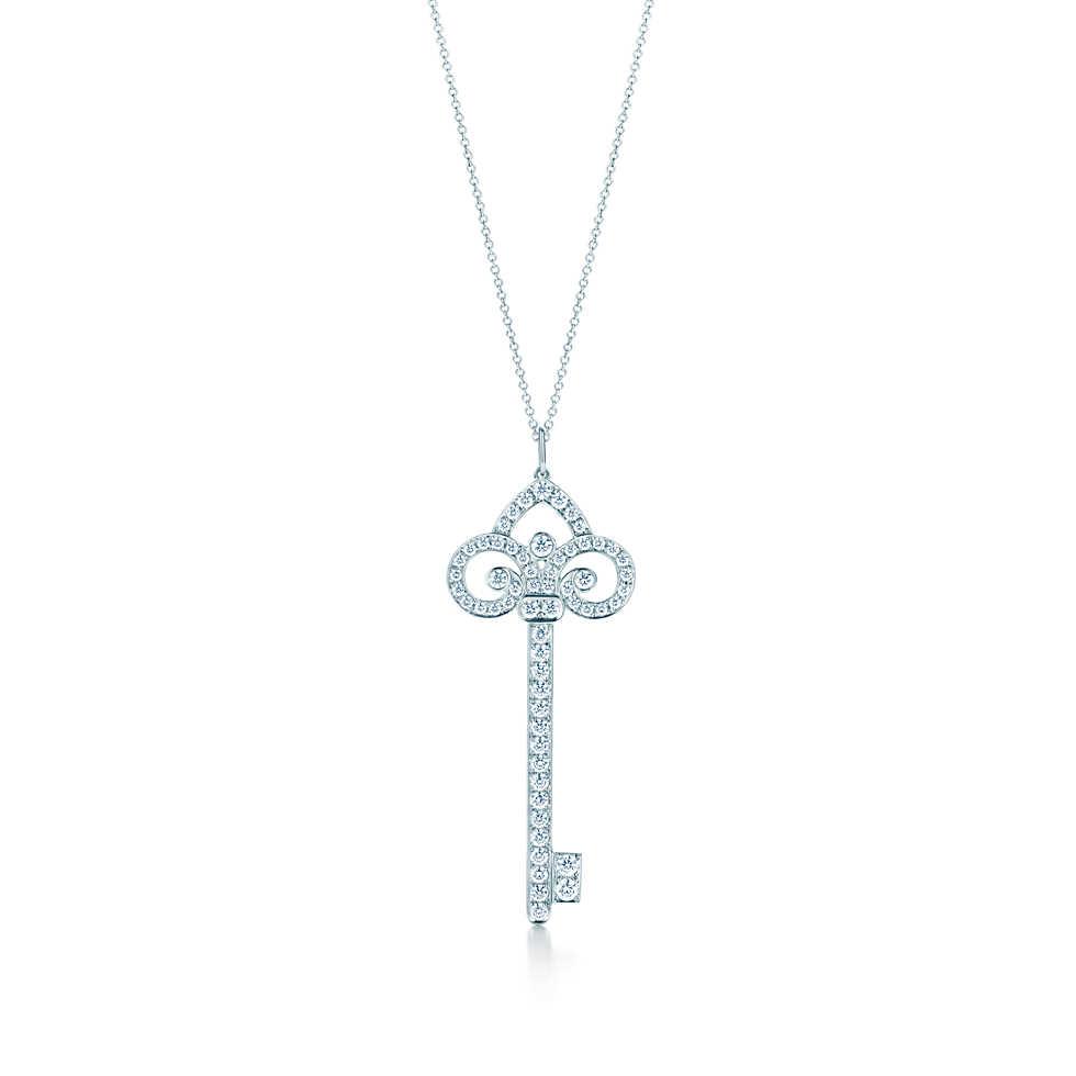Tiffany Keys fleur de lis key pendant in platinum with diamonds on a chain.                                 Tiffany & Co.