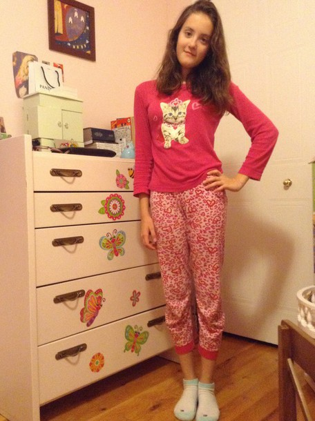 pajamas is a cute pyjama its pink and.  it has a  cute little. cat on it too.