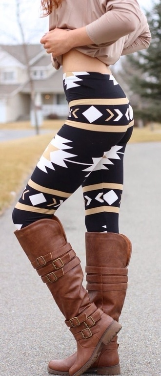 pants aztec leggings navajo leggings black aztec white beige shoes boots fall outfits black tan beige aztec leggings black leggings tribal pattern fashion style tribal leggings brown brown leather boots over the knee boots knee high boots buckle boots