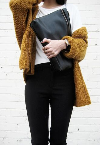 hipster hipster wishlist mustard knitted sweater clutch mustard cardigan knitted cardigan knitwear black jeans black pouch leather pouch college fall outfits fall colors white t-shirt chunky knit cardigan tumblr t-shirt bag black bag denim jeans