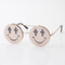 Smiley face cross eyed glasses in shiny gold by jeremy scott at tags