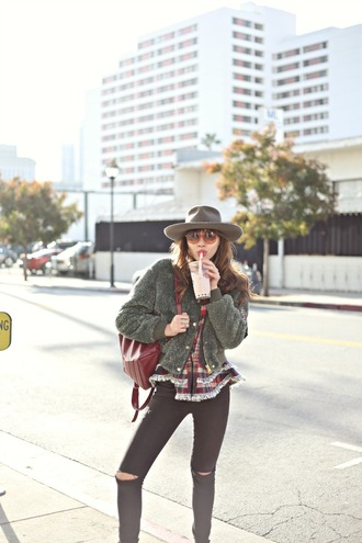natalie off duty blogger fedora round sunglasses fluffy winter jacket top jeans hat sunglasses back to school red backpack grey hat felt hat grey jacket bomber jacket black dress black jeans
