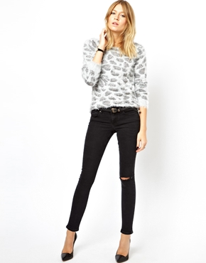 ASOS   ASOS Whitby Low Rise Skinny Ankle Grazer Jeans in Washed Black with Ripped Knee at ASOS