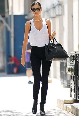 miranda kerr black jeans white shirt black bralette model hot pants boots ankle boots