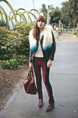 natalie off duty blogger skinny pants backpack faux fur leather jacket 70s style burgundy jacket pants shoes sunglasses jewels