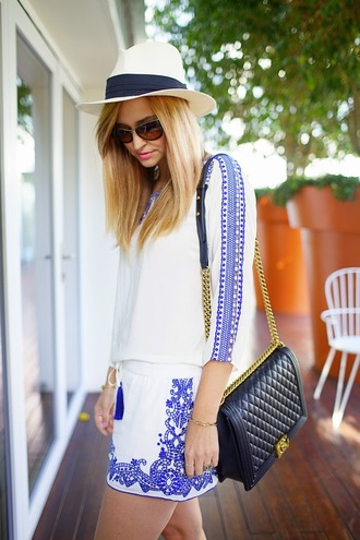 jewels shirt hat shorts shoes bag sunglasses late afternoon