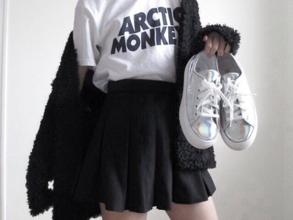 t-shirt band t-shirt black cardigan sweater skirt shoes metallic platform sneakers shirt black black skirt skater skirt arctic monkeys white jacket coat cardigan converse white shoes band t-shirt pale sneakers
