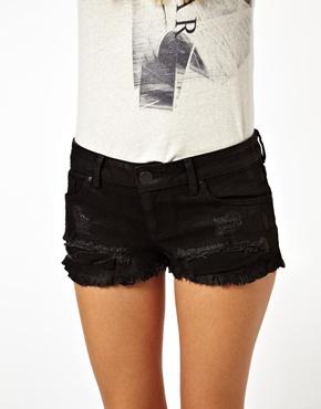 ASOS | ASOS Low Rise Coated Denim Shorts in Black at ASOS
