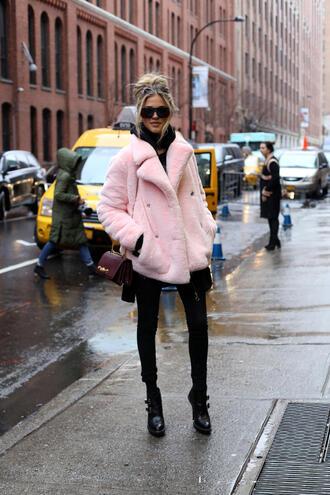 jacket nyfw 2017 fashion week 2017 fashion week streetstyle pink jacket fur jacket faux fur jacket scarf jeans denim black jeans skinny jeans black skinny jeans boots black boots ankle boots high heels boots bag chain bag sunglasses