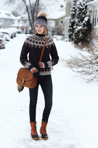 bag district of chic blogger hat sweater gloves shoes knitted gloves christmas sweater printed sweater beanie pom pom beanie grey beanie jeans black jeans winter boots boots brown bag winter outfits winter look holiday season