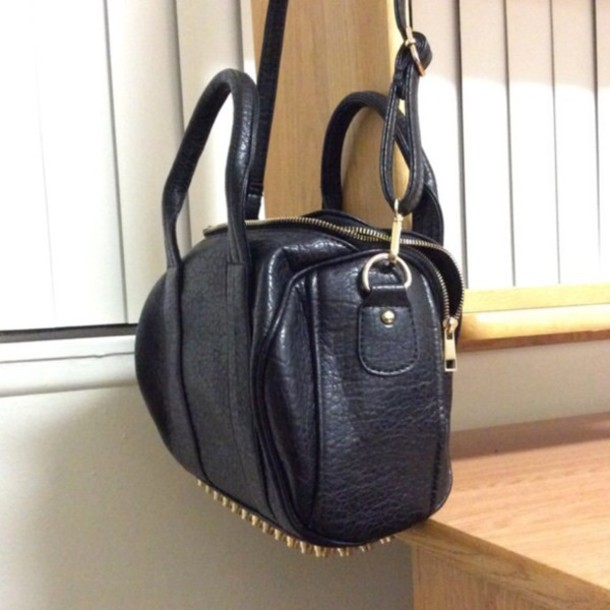 bag black purse with gold studded bottom