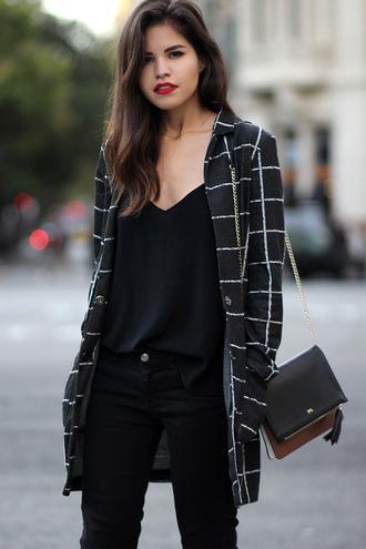 fake leather blogger jeans bag checkered black black jeans printed coat black top black bag red lipstick
