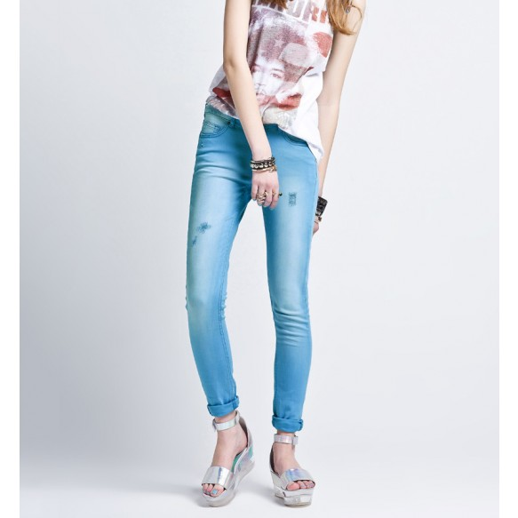 Distressed Skinny Jeans In Light Wash at Style Moi