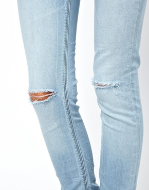 ASOS | ASOS Ridley Ice Blue Super Soft Ultra Skinny Jeans with Ripped Knee at ASOS