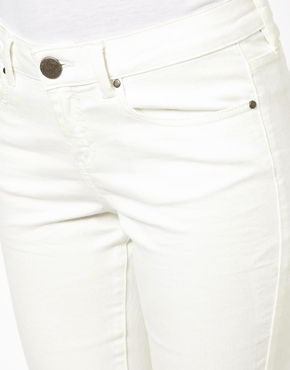 ASOS   ASOS Whitby Low Rise Skinny Ankle Grazer Jeans in White with Ripped Knee at ASOS