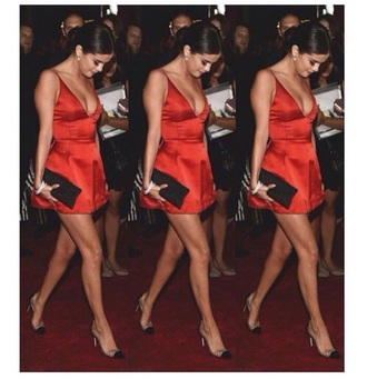 red dress red satin hair selena gomez hair satin dress heels high heels bun selena gomez bag clutch black clutch dress bra dress red silk selena gomez dress mini dress dior straps short short dress homecoming homecoming dress party dress beautiful selena gomez short homecoming dress slip satin dress spaghetti straps dress