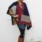 Cara blanket cape with colour block design in multi