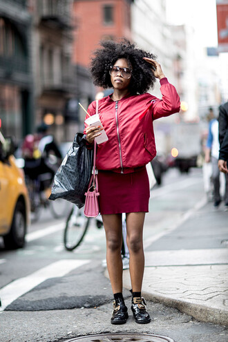 skirt jacket red streetstyle ny fashion week 2017 fashion week 2017 nyfw 2017 fashion week pink jacket bomber jacket pink bomber jacket dress mini dress pink dress boots black boots ankle boots socks bag pink bag curly hair