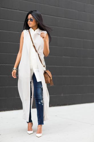 walk in wonderland blogger vest crossbody bag white shirt slanelle ripped jeans