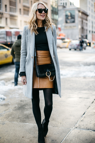 fashionjackson blogger top skirt shoes coat bag tights sunglasses leather skirt crossbody bag gucci bag winter outfits ankle boots