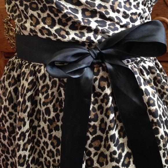 Delia's  - Cheetah dress with black bow sash from Shannon's closet on Poshmark
