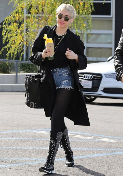 miley cyrus boots bucket bag black coat ripped shorts lace up boots shorts bag