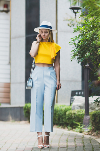 my blonde gal blogger bag pants jewels shoes yellow top high waisted high waisted pants white hat mini bag sandals