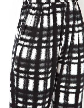 ASOS   ASOS Peg Trousers in Tartan Check Print at ASOS
