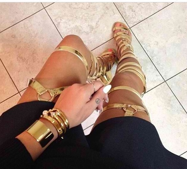 shoes high heels pumps stilettos gladiators strappy heels gold thigh highs knee high legs jewels shirt gold shoes accessories knuckle ring jewelry gold sandals thigh highs gladiators shoes winter gladiator gold chain sandals Gold low heel sandals gold heels heels gladiators