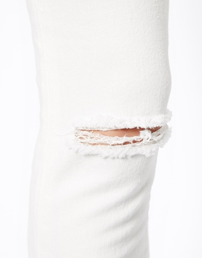 ASOS | ASOS Whitby Low Rise Skinny Ankle Grazer Jeans in White with Ripped Knee at ASOS