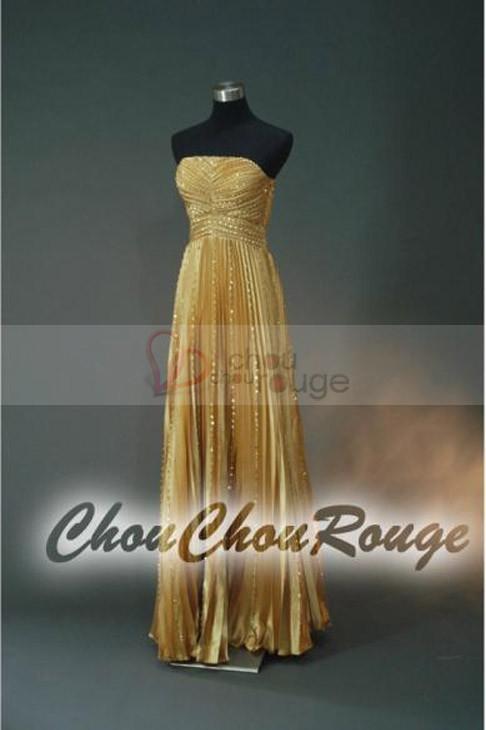 Robe de soirée de noël bustier longue jaune or parcourue de fils dorés Chouchourouge