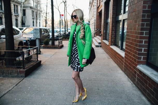 barefoot blonde blogger sunglasses green winter coat patterned dress braid hairstyles shift dress