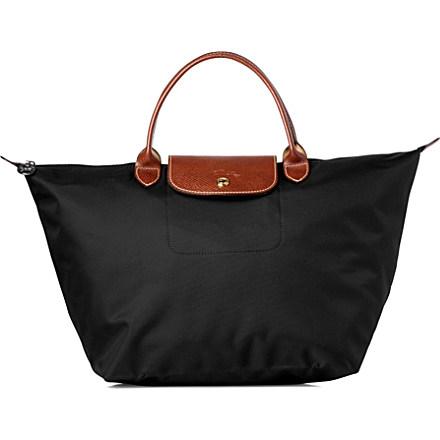 LONGCHAMP - Le Pliage medium handbag in black | Selfridges.com