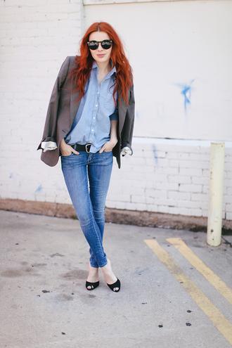 sea of shoes jacket jeans belt
