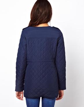 Mama.licious | Mamalicious Collarless Zip Front Quilted Jacket at ASOS