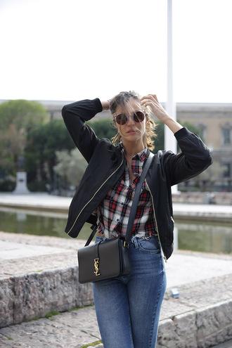 lady addict blogger jeans shirt shoes sunglasses bag ysl ysl bag tiles bomber jacket denim pants