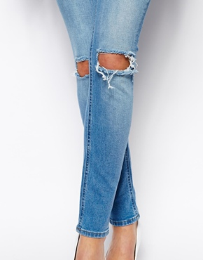 ASOS | ASOS Whitby Low Rise Skinny Jeans in Watercolour Light Wash Blue with Busted Knees at ASOS