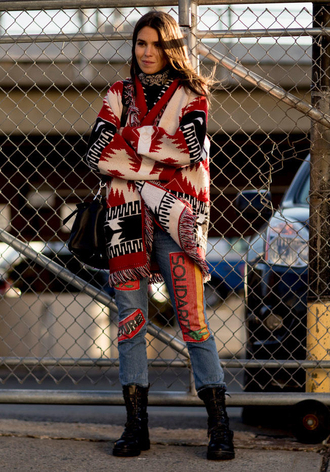 cardigan flat boots nyfw 2017 fashion week 2017 fashion week streetstyle printed cardigan denim jeans blue jeans black boots boots flashes of style black bag